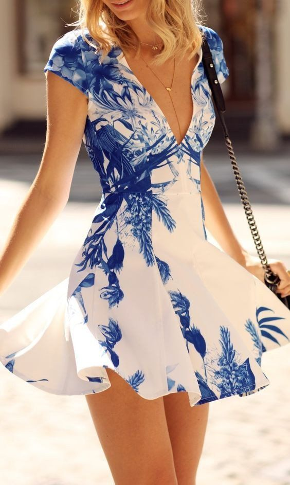 A skater dress with an allover floral print, underskirt lined interior, slightly…