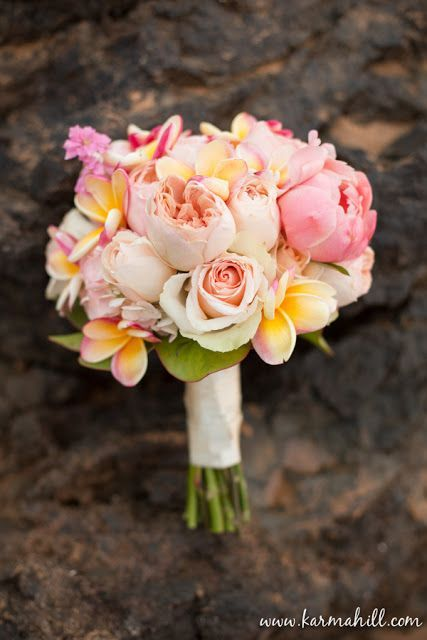 Plumeria and peonies.  Sooo pretty. Maybea hibiscus?  -kendra wedding bouquets plumerias peonies
