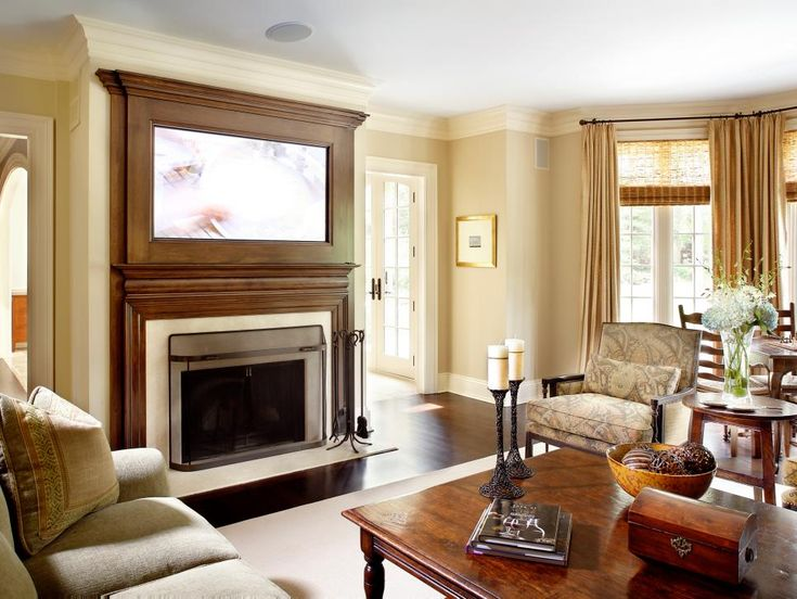 A High Definition Television Is Mounted Into The Fireplace Mantel With Finish That Mirrors