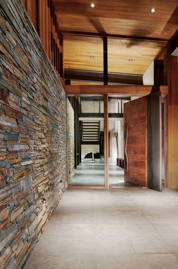 New York loft meets mountain modern living in Lake Tahoe. Walnut-and-steel pivot door.