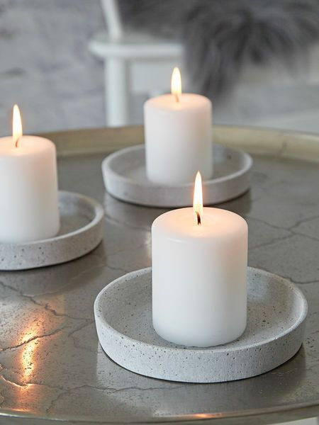 These uber cool polystone concrete grey candle trays are bang on trend.