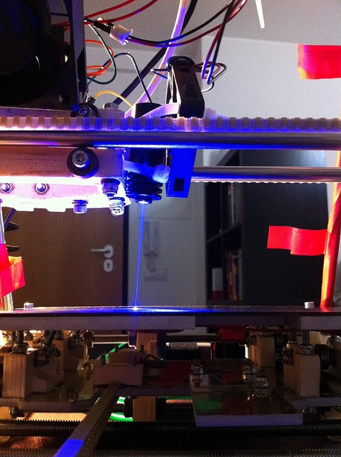 cheap laser cutter on a 3d print head. Laser etching a PCB with mendel by Reonarudo, via Flickr