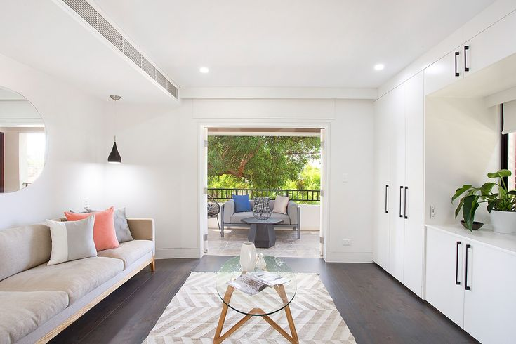 Casual living, coffee table, throw cushions, ducted air con, mirror, downlights, private balcony, city views, Pilcher Residential