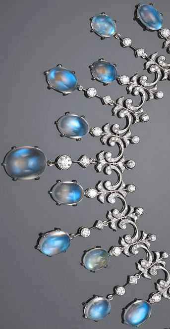 A moonstone and diamond necklace total moonstone weight: 49.50 carats;  diamond weight: 4.95 carats; mounted in eighteen karat white gold; length: 16 1/4in.