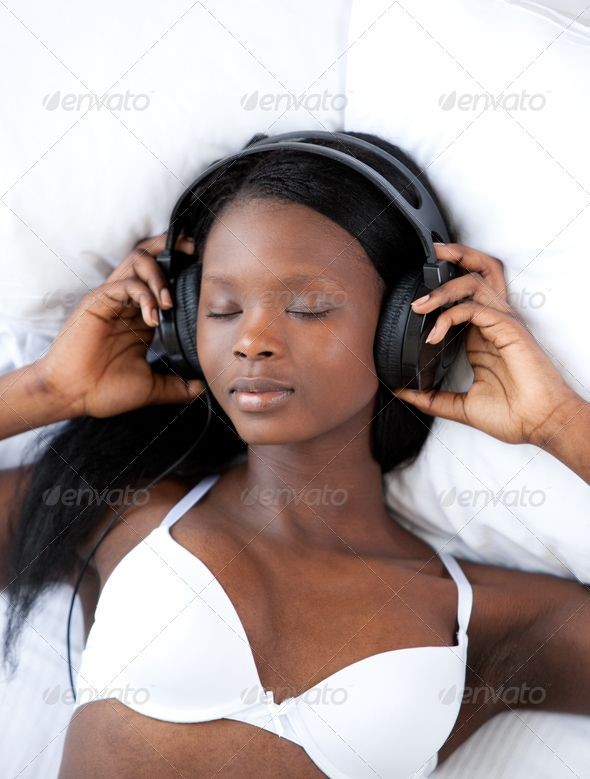 Radiant woman listening music lying on her bed ...  adult, attractive, beautiful, bed, bedroom, bright, charming, cheerful, classical, delighted, earphones, elegant, female, fun, happy, headphone, headphones, headset, home, indoors, interiors, jazz, jolly, joyful, lingerie, listen, listening, lying down, merry, music, positive, pretty, radiant, relax, relaxation, rock, sensuality, sexy, smile, song, soul, sound, swing, tune, underwear, white, woman, women, young