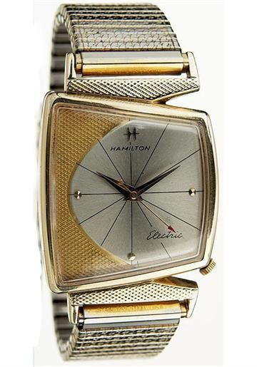 1961 vintage watch - probably belong to a chevy driver....reminds me of the fenders!