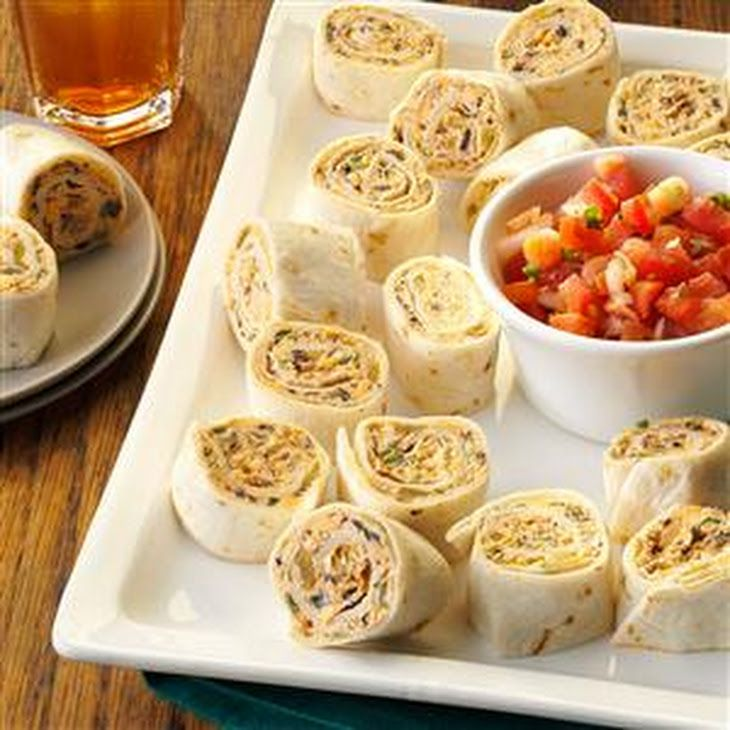 Fiesta Pinwheels Recipe Appetizers with cream cheese, sour cream, picante sauce, taco seasoning, garlic powder, ripe olives, chopped green chilies, shredded cheddar cheese, sliced green onions, flour tortillas, salsa