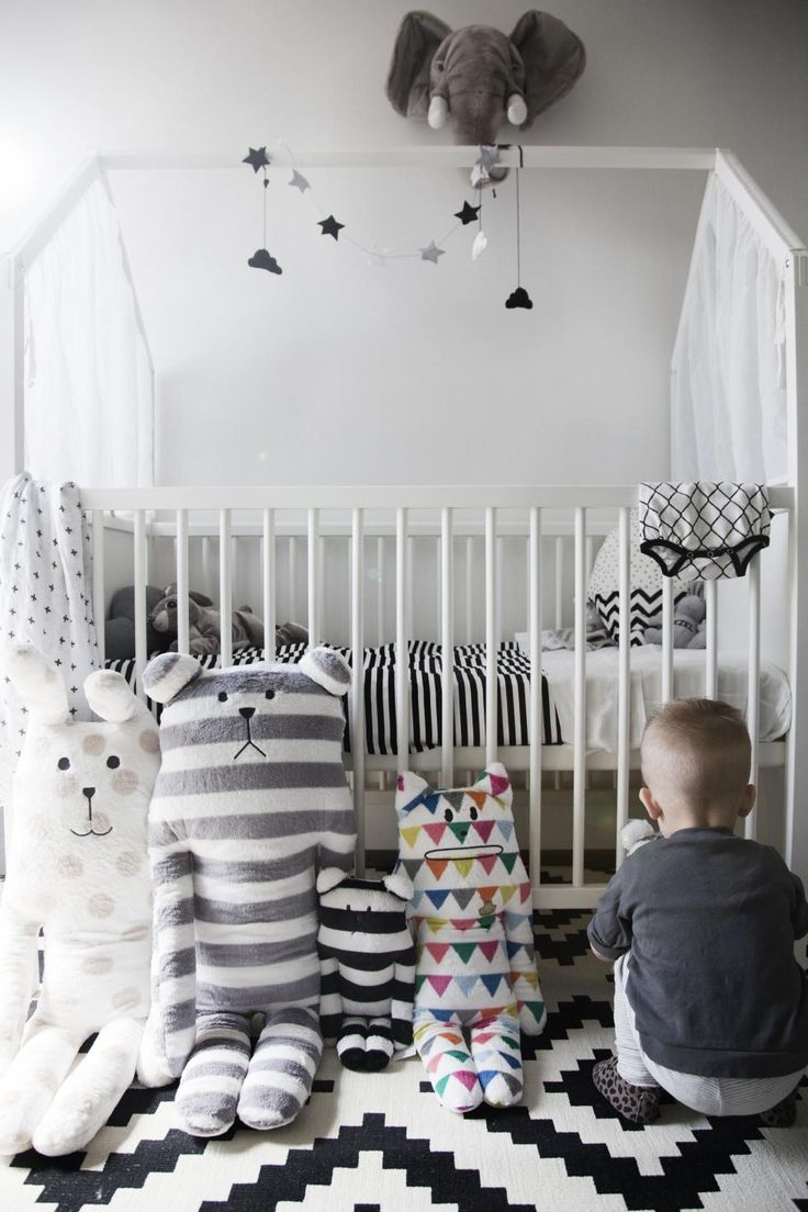 Stunning Scandinavian inspired nursery featured Stokke Home Crib in White (Mix Patterns Pillows)
