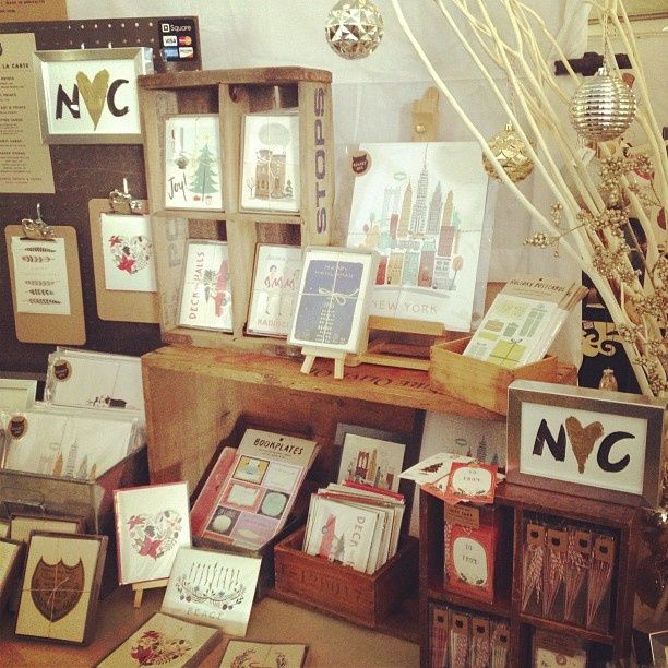 Boxes, mini easels, black pegboard with clipboards holding product