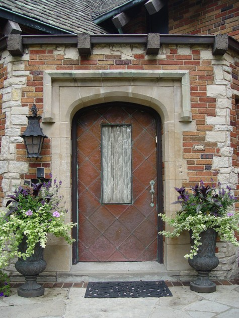 Exterior Of Mudroom Addition In Portland Oregon I Love The Porch: Stunning Urn Planters Add Charm To This #entryway.