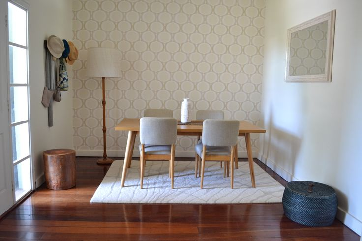 Entry / dining with mid century modern hint, geometric wallpaper Jarrah floor neutral colours