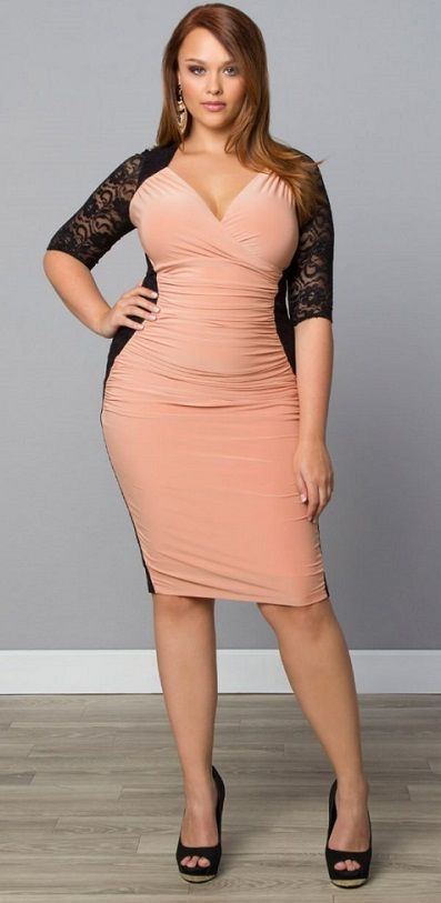 This is an example of a dress that flatters the hourglass figure because it has the shade of black around her hips and also makes her bust and thighs bigger.