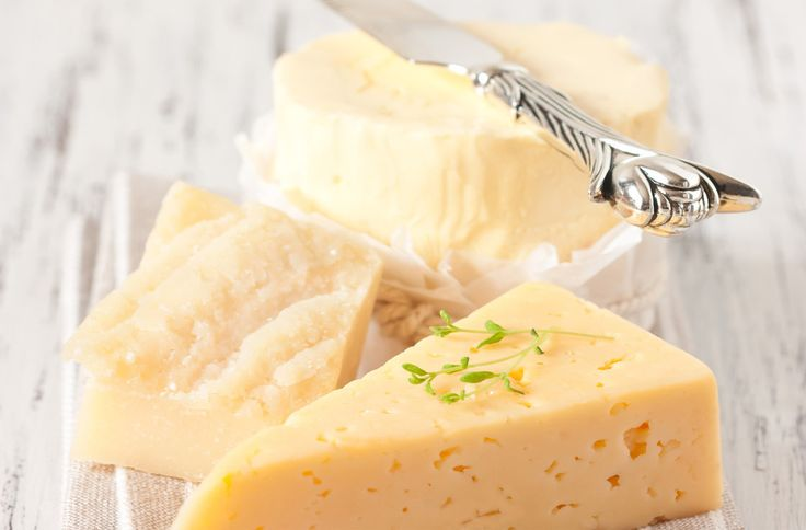 Cheese won't go hard while storing, if you spread some butter over the corners that may be exposed!