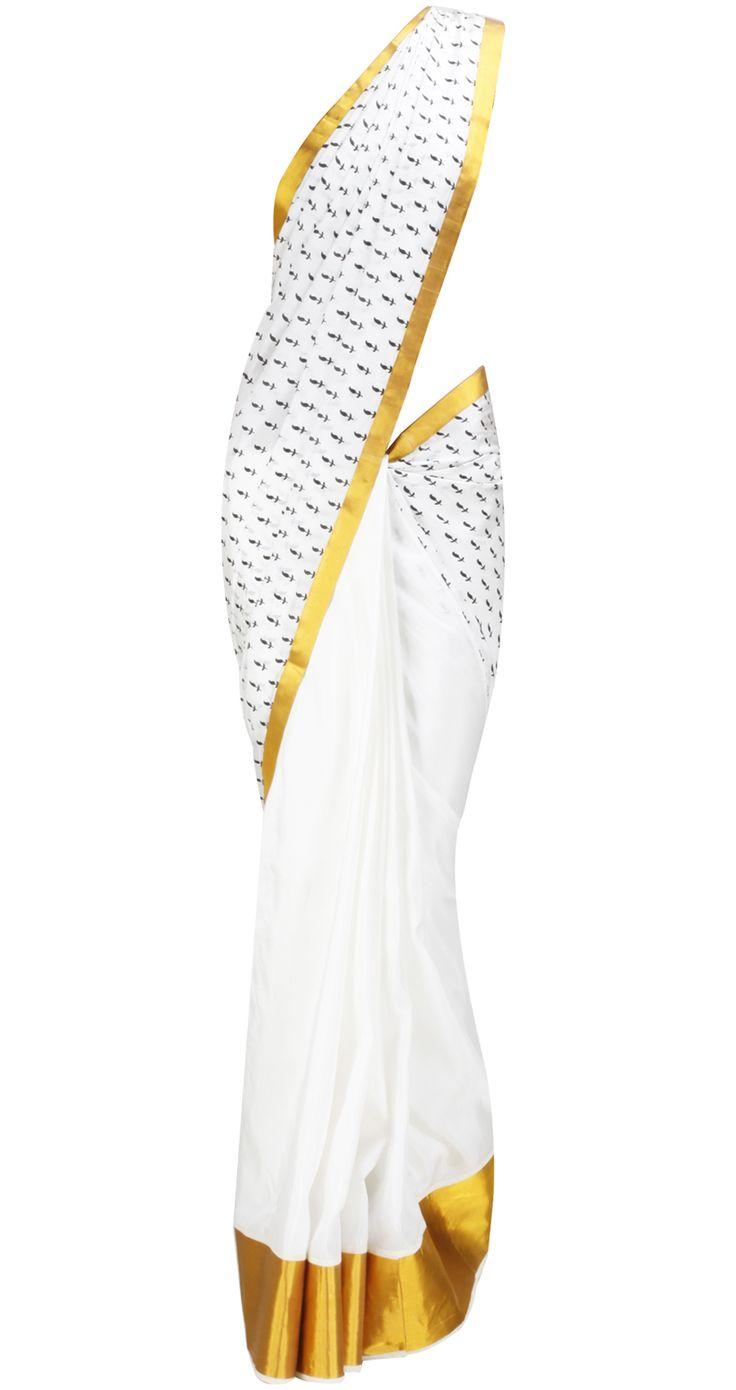 White Saree with Gold border by MASABA. Shop at https://www.perniaspopupshop.com/whats-new/masaba-5206