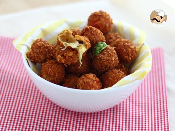 Pomodori ciliegini ripieni di pesto e mozzarella, impanati e fritti. Da provare assolutamente! - Ricetta Stuzzicherie : Pomodorini croccanti da Petitchef_IT