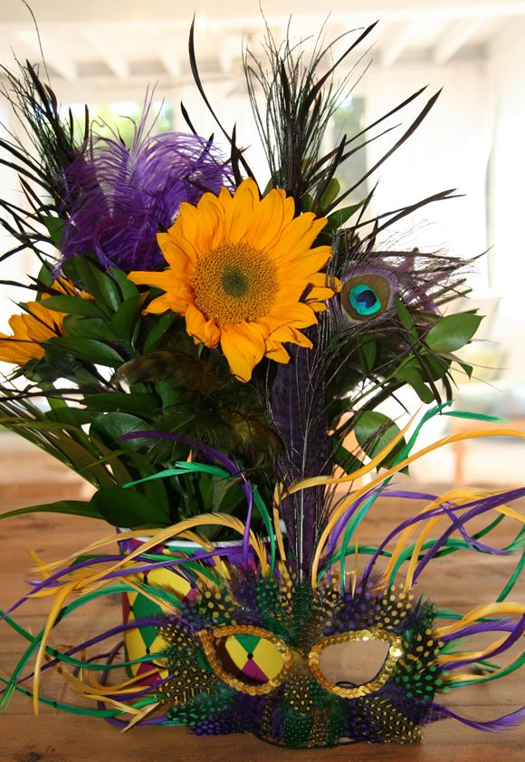 Feathers, mask and sunflower centerpiece for Mardi Gras.