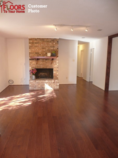 This Pergo Click-Together laminate flooring in Red Oak looks great next to  this brick
