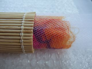 Flat wet felting with yarn inclusions tutorial.