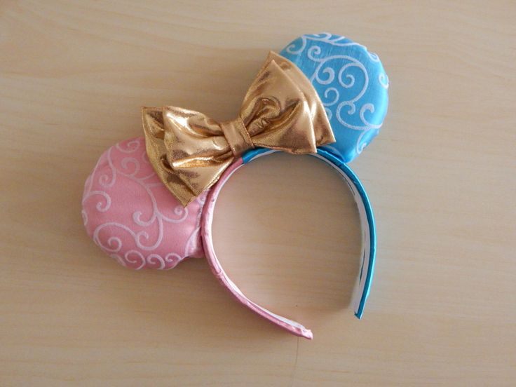 Cute ears for a gender reveal! Sleeping Beauty-Inspired Minnie Ears by TheRedKnotShop on Etsy https://www.etsy.com/listing/253834624/sleeping-beauty-inspired-minnie-ears