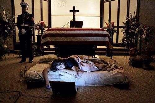 """The night before the burial of her husband 2nd Lt James Cathey of the US Marine Corps, killed in Iraq, Katherine Cathey refused to leave the casket, asking to sleep next to his body for the last time. The Marines made a bed for her. Before she fell asleep, she opened her laptop computer and played songs that reminded her of """"Cat"""". I am not sure what is more honorable: Being married to this faithful wife to the end or the Marine standing next to the casket watching over them both.: 2Nd En, Plays Songs, Stands Watches, Fell Asleep, Be Kind, U.S. States, United States, Marines Corps, States Marines"""