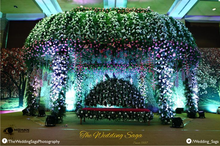 Experience a floral bliss on your special day with flowers and petals ornamenting the canopy. #TheWeddingSaga #MohanColorLab #Wedding #Decor
