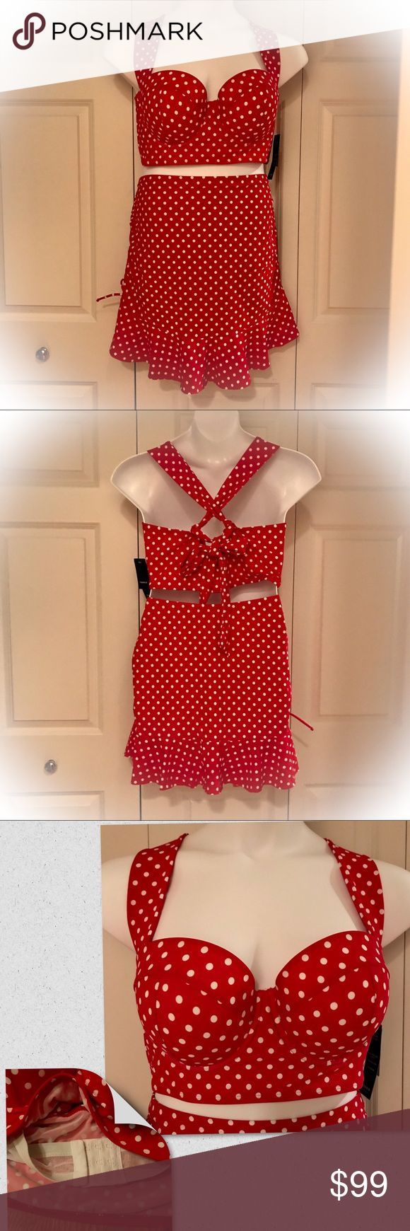 """✳️ NWT! Torrid Dot Swimsuit NWT! Old fashion style swimsuit in fun red with white polka dots. Molded cup push-up bra with adjustable tie straps and interior regular bra hook closure for a perfect fit. High waisted skirt that conceals and flatters hips, with adjustable length due to a drawstring on each side. Waist 18"""", length 19"""" (at longest) including a 5"""" ruffle. BRAND NEW from last summer, bought at full price. torrid Swim"""