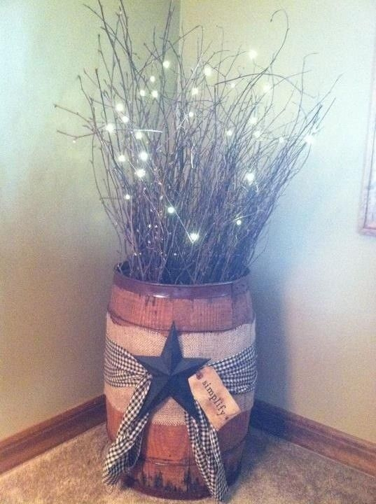 This is an old nail drum from coal mines. I decorated with twigs, lights, homespun fabric, piece of burlap , star - Click image to find more Home Decor Pinterest pins