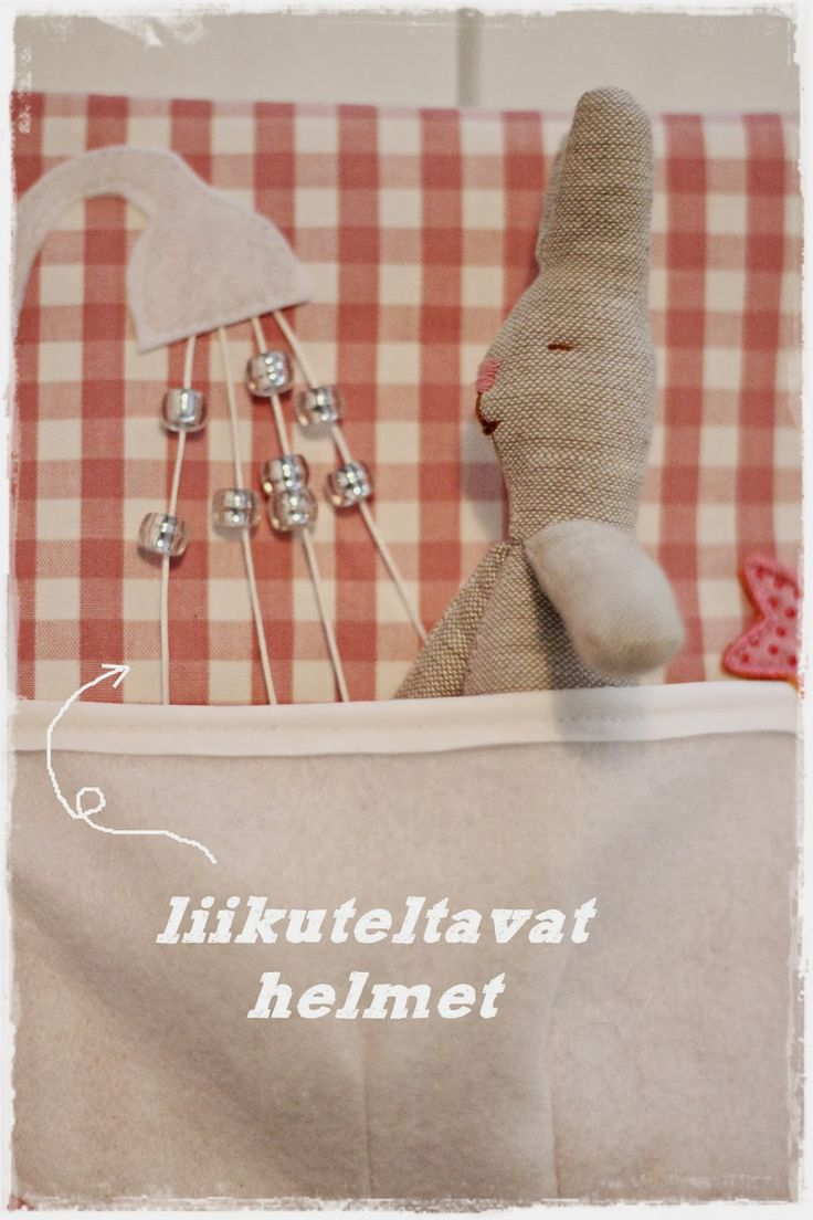Bunny in the bath. Love the beads on string for shower. ripaus tunnelmaa: pehmoinen kirja