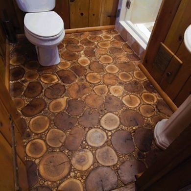 Wood...With a Twist - Who says hardwood floors have to be boring? Created by Chicago flooring company Birger Juell Ltd., this bathroom floor comprises horizontal cuts of oak, birch, and maple, as well as tiny twigs and branches gathered from the client's property.