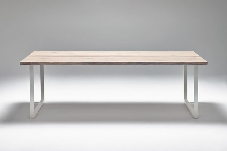 Nevian dining table; Edge. Whitewashed oak and white steel base.