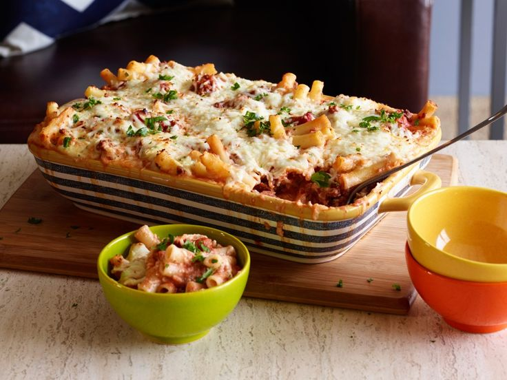 Ree creates a delicious three-cheese mixture of Parmesan, mozzarella and ricotta to add welcome creaminess to her Baked Ziti recipe.