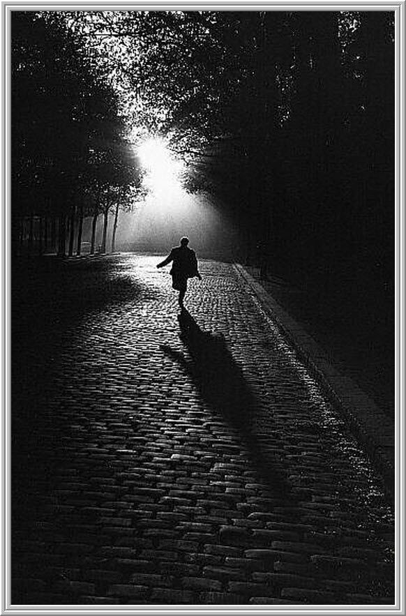 Brassai   This is an amazing photo.  You can feel the air. Hear the sound as the souls of his shoes hit the ground.