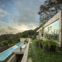 Casa AL by Studio Arthur Casas in Rio de Janeiro sits between a mountain and the ocean.