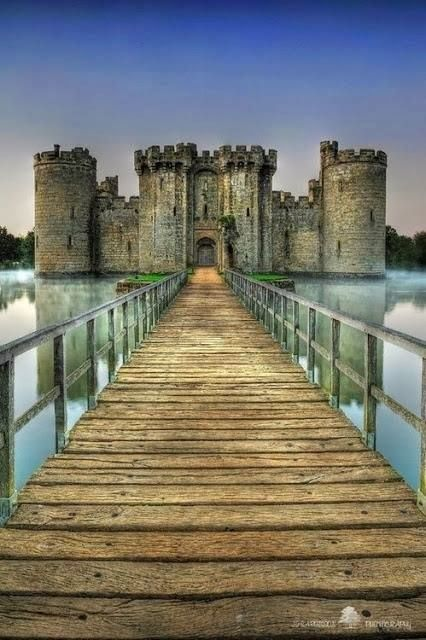 Bodiam Castle is a 14th-century moated castle near Robertsbridge in East Sussex, England. Built in 1385 by a former knight of Edward III, with the permission of Richard II, ostensibly to defend the area against French invasion during the Hundred Years' War. Its corners and entrance are marked by towers, and topped by crenellations.
