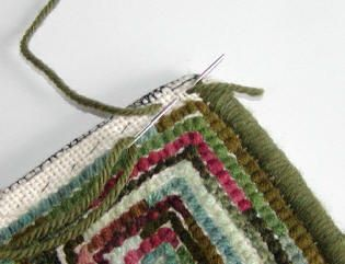 How to whip a hand hooked rug tutorial- includes a trick for nice corners.  Have you tried this method?