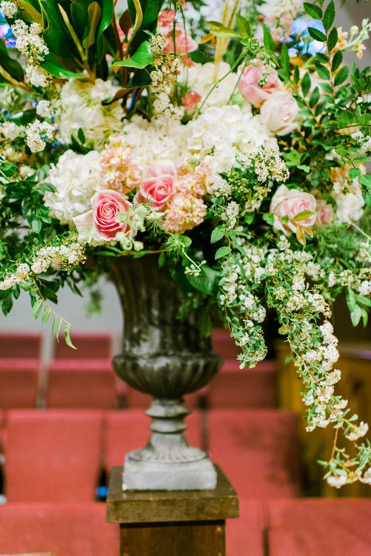 detail of loose altar urn arrangement of white hydrangea, rosita vendela rose, pink larkspur, white spirea, peach stock, magnolia & elm.