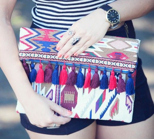 Embroidered fold-over clutch with colorful tassel detailing