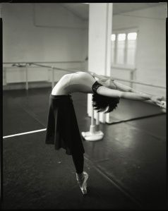 Backbend. Stretching on the barre.