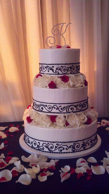 beautiful round three tier wedding cake with simple black piping