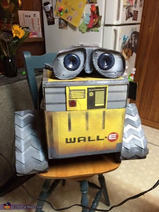 Karen: My son Henry (age 3) is wearing the Wall-e costume. This is his favorite movie right now. We used cardboard, hot glue, plastic bottles and spray paint. Attaching the head...