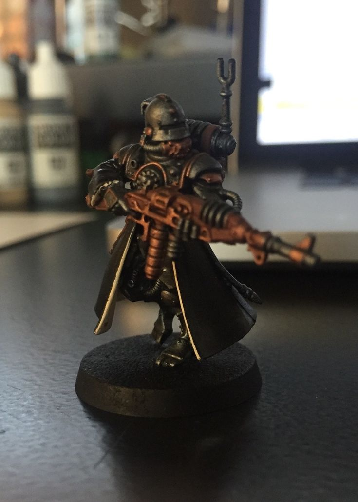 Based vanguard model. Looks pretty nice in black… But alas the red coats of Mars are up next. I haven't glued this models legs to the body just yet. It makes it easier to paint inside the robes.