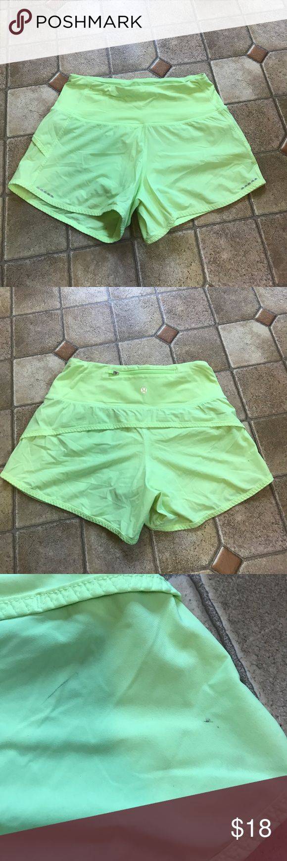 Lululemon neon green speed shorts size 2 Lululemon neon speed shorts size 2. Shorts have a zippered pocket on the back waist band. Shorts are in good used condition but do have some marks on the back side as pictured. lululemon athletica Shorts