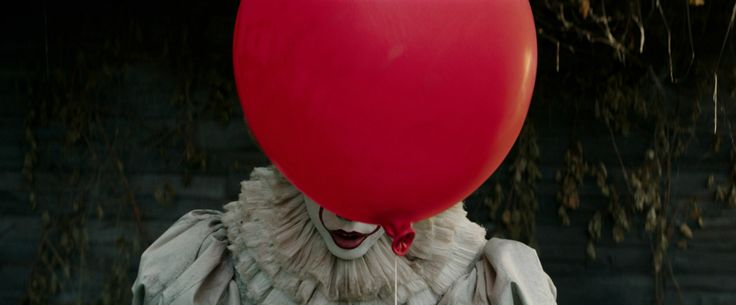 """BILL SKARSGÅRD as Pennywise in New Line Cinema's horror thriller """"IT,"""" a Warner Bros. Pictures release."""