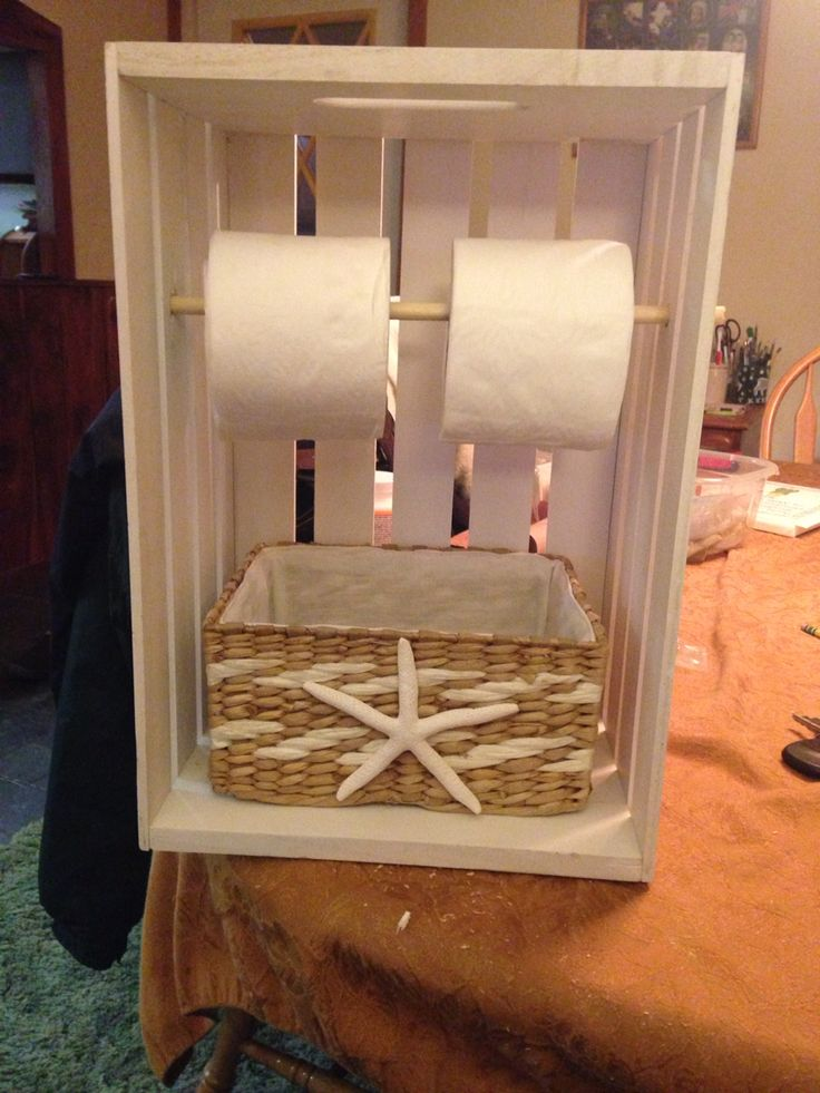 Addition to my beach themed bathroom. A white washed wooden crate, a dowel, basket and starfish were all purchased from Joann's to make this toilet paper holder