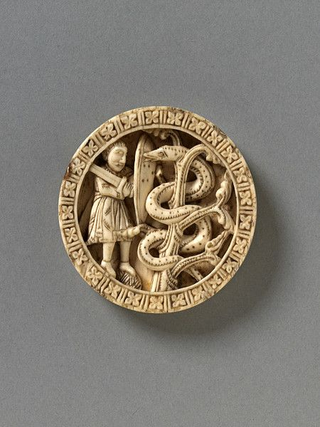 Tableman - Germany, ca 1150. Backgammon playing piece depicting Hercules performing his 11th labor, a rare motif in Western medieval art of this period