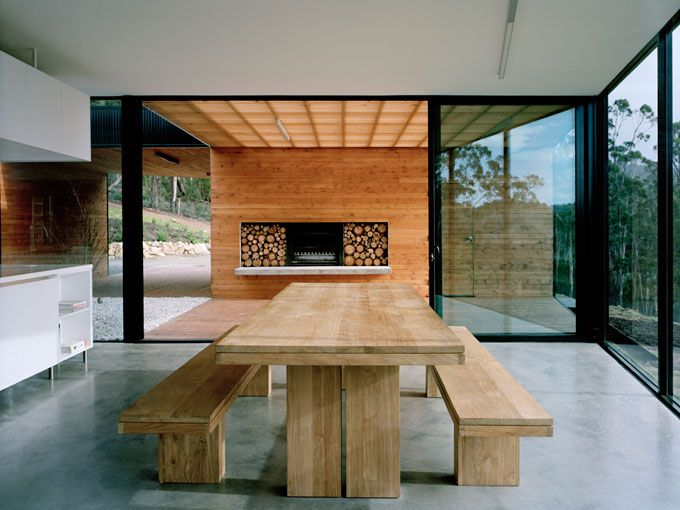 polished concrete, white kitchen, black frames, wood fire, timber decking, what's not to love?!
