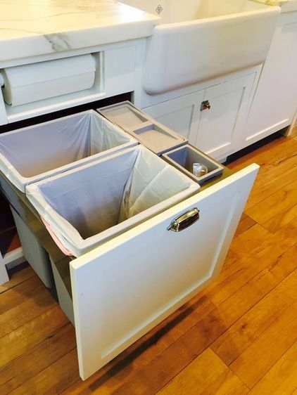 Pull-out trashcan with recycling bin and special compartment for compost; also note the papertowls built-in on top - pulls out to store the rest of the paper towels