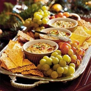 Presentation idea. Long tray with bowls of dip, fill in w crackers and grapes.