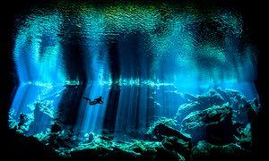 British underwater photographer of the year – winner. Out of the Blue by Nick Blake (UK). Location: Yukatán peninsula, Kukulkan  Kukulkan, one of the spectacular cenotes on Mexico's Yucatán peninsula, is noted for its otherworldy light as sunbeams penetrate the darkness of the cave. Blake captured this diver in the centre of one of the beams.