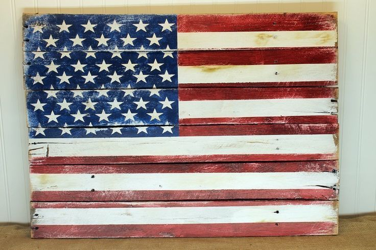 American Flag Wall Art Sign from Reclaimed Pallet Wood, Red White and Blue Painted Americana Design 24x14 or larger. An American flag made and distressed from reclaimed pallet wood is the perfect way to express your patriotism anytime of the year. Approximately 24x14 (see options to the right for larger sizes), constructed with thin straps of pallet wood across the back and a rustic wire for hanging. This sign is sealed for indoor or outdoor use. Every design is intentionally distressed…
